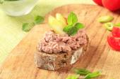 Bread with meat spread — Stock Photo