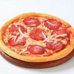 Pizza Pepperoni on cutting board — Stock Photo #74595239
