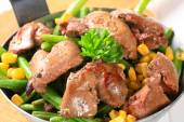 Chicken livers with green beans and corn — Stock Photo