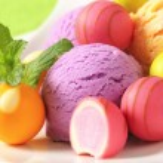 Fruit-flavored ice cream and pralines — Stock Photo #78922352