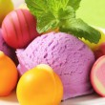 Fruit-flavored ice cream and pralines — Stock Photo #78922494