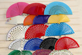 Colorful fans at a street market in Seville, Andalusia, Spain — Stock fotografie