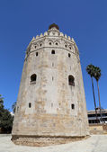 Torre del Oro or Golden Tower (13th century), a medieval Arabic military dodecagonal watchtower in Seville, Andalusia, southern Spain — Stock Photo