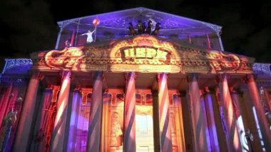 Big (Bolshoy) theatre at night illuminated for international festival  Circle of light on October 13, 2014 in Moscow, Russia — Stock Video