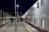Train on Leningrad railway station at night -- is one of the nine main railway stations of Moscow, Russia — Stock Photo