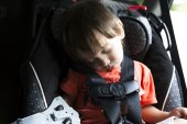 Sweet Child In His Safety Car Seat — Zdjęcie stockowe