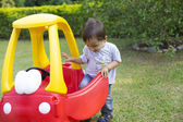 Happy Little Boy Driving His Toy — Stock Photo