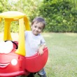 Happy Little Boy Driving His Toy — Stock Photo #57754257