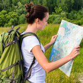 Woman hiker reading map — Stock Photo