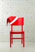 Santa hat on chair — Stock Photo