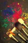 Makeup brushes with colorful powder — Stock Photo