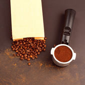 Espresso in a holder and coffee beans — Stock Photo