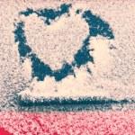 Heart shape on snow — Stock Photo #65236245