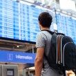 Guy near airline schedule — Stock Photo #52587103
