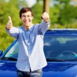 Guy with car key shows thumb up — Stock Photo #60468313