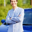 Young man leaning against car with crossed arms — Stock Photo #60468421