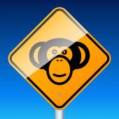 Monkey on road — Stock Vector