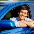 Guy looking out through open car window — Stock Photo #70431399