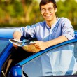 Guy with map near car — Stock Photo #70432015