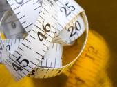 Tape measure on yellow background — Stock Photo