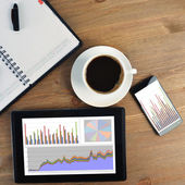 Tablet pc and cup of coffee — Stock Photo