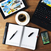 Notebook and cup of coffee — Stock Photo