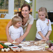 Mother with children prepare dough — Stock Photo