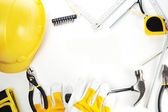 Hardhat, gloves and hammer — Stock Photo