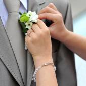 Wedding boutonniere  on jacket of groom — Stock Photo