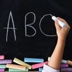 Hand of child writing words — Stock Photo #69209737