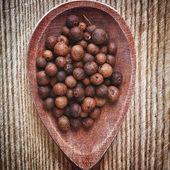 Allspice grain in spoon — Stock Photo