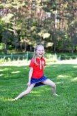 Girl on green lawn — Stock Photo