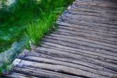 Wooden bridge over water surface — Stock Photo