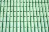 Green metal tile house roof as texture — Stock Photo