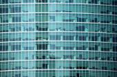 Modern office building glass wall front view close-up — Stock Photo