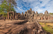 SIEM REAP-CAMBODIA. The Bayon Temple is one of the most significant historical and religious sites in the Angkor Thom area. The ruins feature over one hundred huge faces carved into the towers. — Stock Photo
