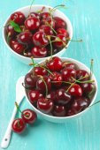 Cherries in bowls — Stock Photo