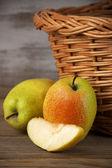 Pears near basket — Stock Photo