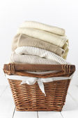 Sweaters in basket — Stock Photo