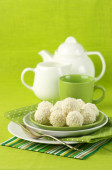 Coconut candies and tea — Stock Photo