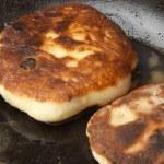 Cooking: frying pancakes — Stock Photo #56904195