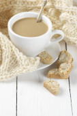 Coffee with cookies and knitwear — Stock Photo
