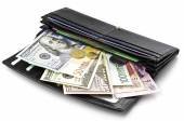 Various currencies in purse — Foto Stock