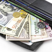 Various currencies in purse — Stock Photo
