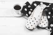 Feminine slippers, knitwear and coffee — Stock Photo