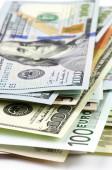 Various currencies close-up — Stock Photo