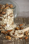 Oatmeal flakes with nuts — Stock Photo