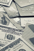 Money pile and plastic cards — Stock Photo