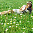 Young woman photographer in grass — Stock Photo #73499929