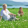 Great grandmother and great granddaughter in meadow — Stock Photo #76214779